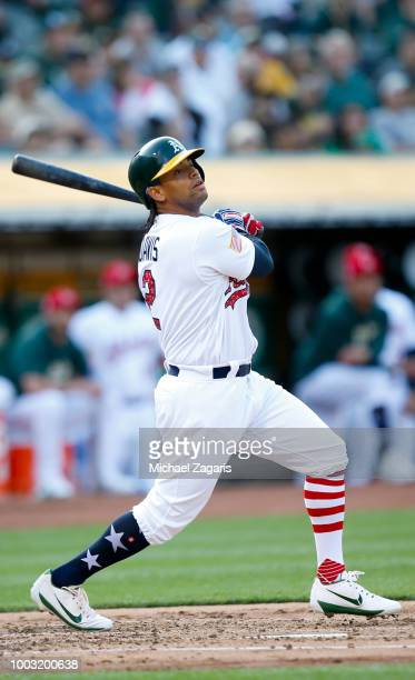 Khris Davis of the Oakland Athletics bats during the game against the San Diego Padres at the Oakland Alameda Coliseum on July 3 2018 in Oakland...