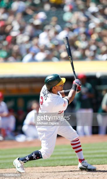 Khris Davis of the Oakland Athletics bats during the game against the San Diego Padres at the Oakland Alameda Coliseum on July 4 2018 in Oakland...