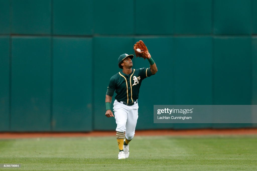 Khris Davis #2 of the Oakland Athletics catches a fly ball hit by Kyle Seager #15 of the Seattle Mariners in the fifth inning at Oakland Alameda Coliseum on August 9, 2017 in Oakland, California.
