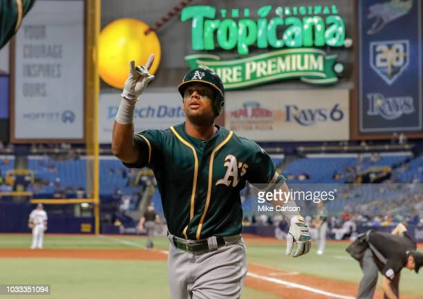 Khris Davis of the Oakland Athletics celebrates after his home run in the tenth inning of a baseball game against the Tampa Bay Rays at Tropicana...