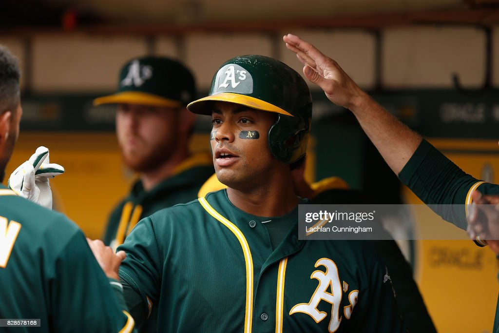 Khris Davis #2 of the Oakland Athletics celebrates in the dugout after hitting a solo home run in the third inning against the Seattle Mariners at Oakland Alameda Coliseum on August 9, 2017 in Oakland, California.