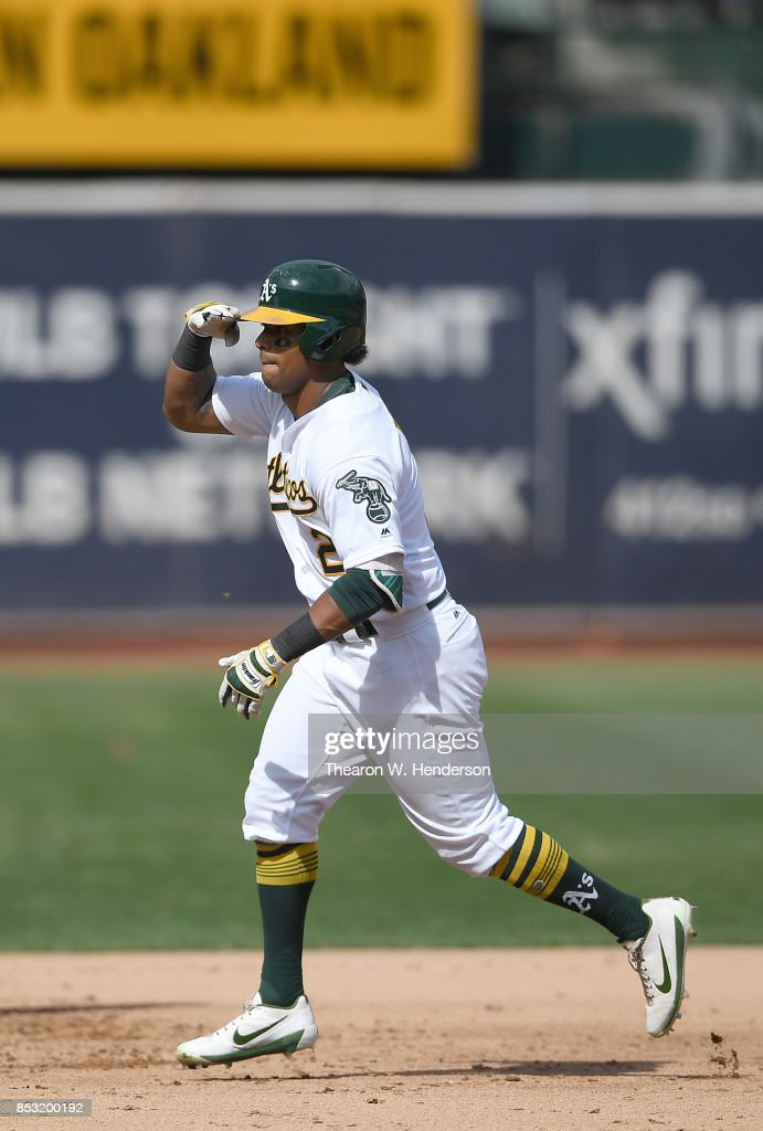 Khris Davis #2 of the Oakland Athletics celebrates with a salute as he trots around the bases after hitting a two-run homer against the Texas Rangers in the bottom of the fifth inning at Oakland Alameda Coliseum on September 24, 2017 in Oakland, California.