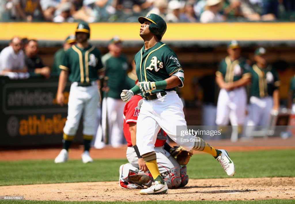 Khris Davis #2 of the Oakland Athletics crosses home plate after hitting a home run in the fourth inning against the Los Angeles Angels at Oakland Alameda Coliseum on September 6, 2017 in Oakland, California.