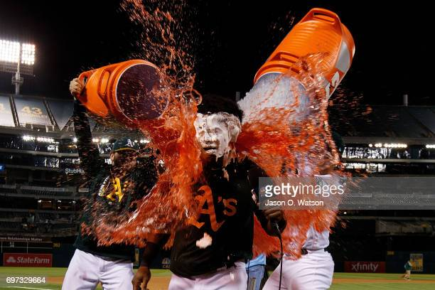 Khris Davis of the Oakland Athletics has Gatorade poured on him after hitting a two run walk off single after the game against the New York Yankees...