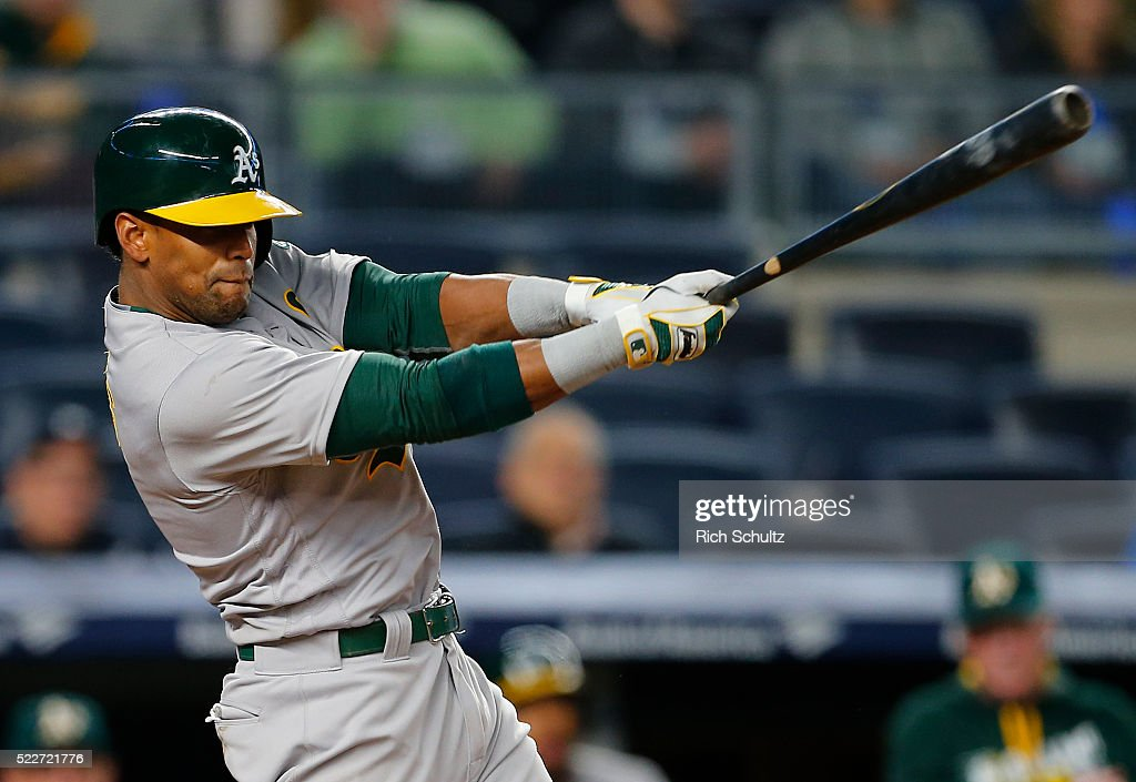 Khris Davis #2 of the Oakland Athletics hits a single that scores two in eighth inning against the New York Yankees at Yankee Stadium on April 20, 2016 in the Bronx borough of New York City. The A's defeated the Yankees 5-2.
