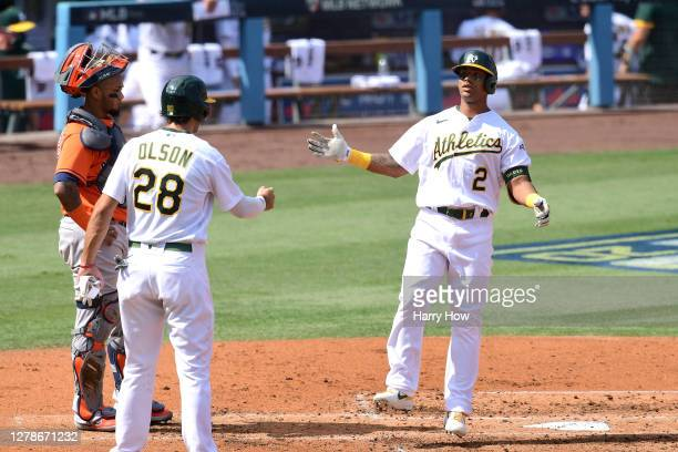 Khris Davis of the Oakland Athletics hits a two run home run against the Houston Astros during the second inning in Game One of the American League...