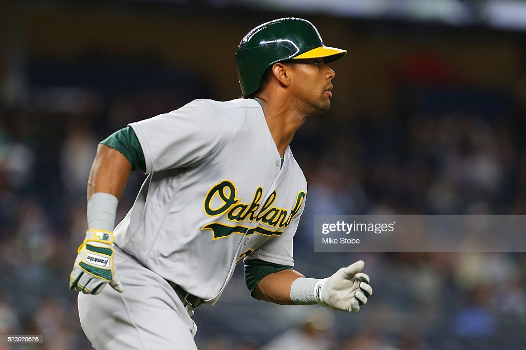 Khris Davis #2 of the Oakland Athletics rounds first base after hitting a solo home run in the seventh inning against the New York Yankees at Yankee Stadium on April 21, 2016 in the Bronx borough of New York City.