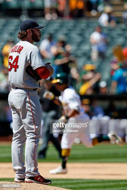 Khris Davis of the Oakland Athletics rounds the bases after hitting a two run home run off of Ben Taylor of the Boston Red Sox during the fifth...