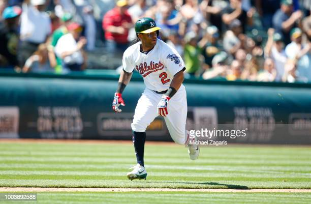 Khris Davis of the Oakland Athletics runs the bases during the game against the San Diego Padres at the Oakland Alameda Coliseum on July 4 2018 in...