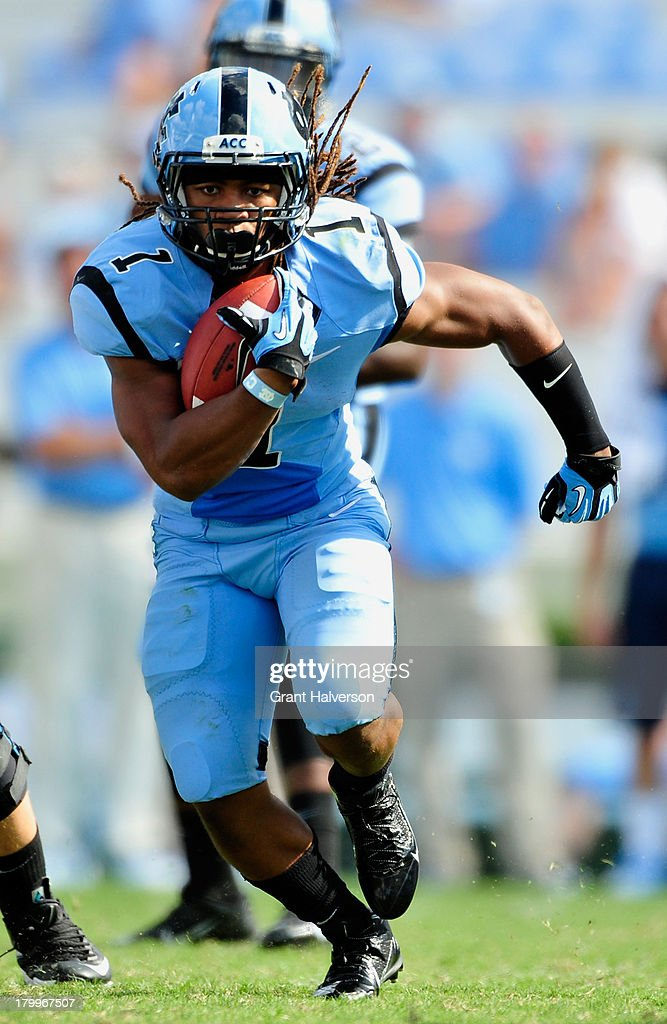 Khris Francis #1 of the North Carolina Tar Heels carries the ball against the Middle Tennessee State Blue Raiders during play at Kenan Stadium on September 7, 2013 in Chapel Hill, North Carolina. North Carolina won 40-20.