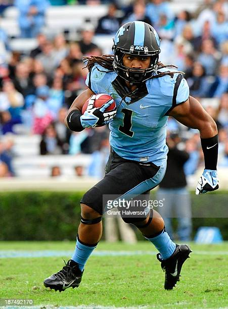 Khris Francis of the North Carolina Tar Heels runs against the Virginia Cavaliers during play at Kenan Stadium on November 9 2013 in Chapel Hill...