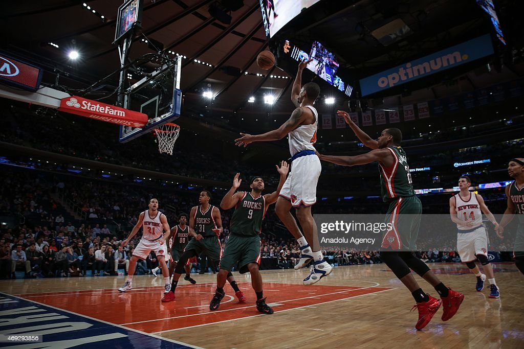 Khris Middleton #22 and John Henson #31 of the Milwaukee Bucks in action against Lance Thomas (C), Lou Amundson #21 and Jason Smith (R) of the New York Knicks at Madison Square Garden on April 10, 2015 in New York, New York.
