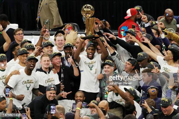 Khris Middleton and members of the Milwaukee Bucks celebrate after defeating the Phoenix Suns in Game Six to win the 2021 NBA Finals at Fiserv Forum...