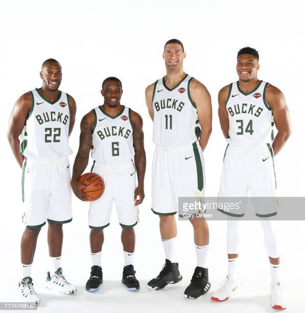 Khris Middleton Eric Bledsoe Brook Lopez and Giannis Antetokounmpo of the Milwaukee Bucks pose for a portrait during Media Day at the Froedtert the...