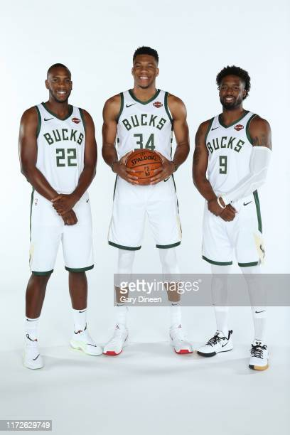Khris Middleton Giannis Antetokounmpo and Wesley Matthews of the Milwaukee Bucks pose for a portrait during Media Day at Fiserv Forum on September 30...