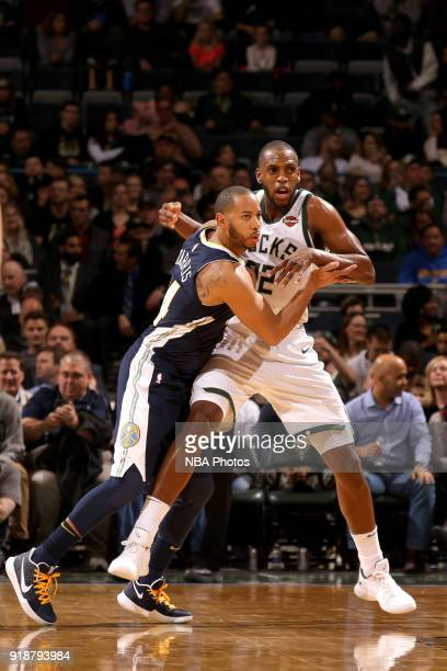 Khris Middleton of the Milwaukee Bucks and Devin Harris of the Denver Nuggets box each other out on February 15 2018 at the BMO Harris Bradley Center...