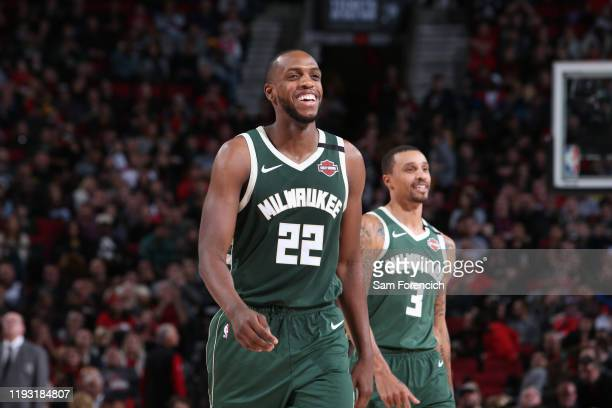 Khris Middleton of the Milwaukee Bucks and George Hill of the Milwaukee Bucks smiles during the game against the Portland Trail Blazers on January 11...