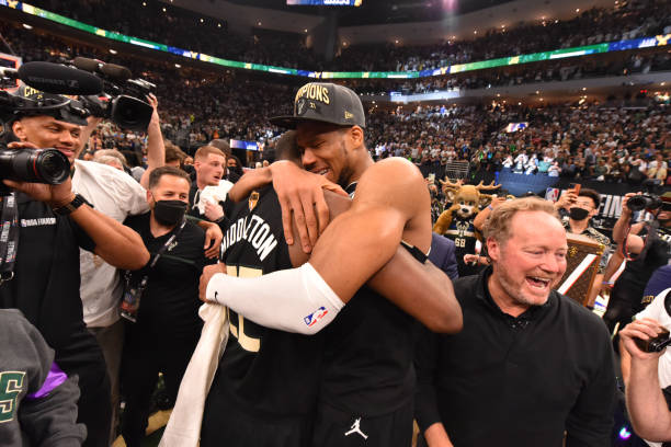 Khris Middleton of the Milwaukee Bucks and Giannis Antetokounmpo of the Milwaukee Bucks hug after winning Game Six of the 2021 NBA Finals against the...