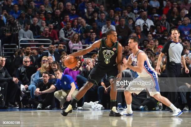 Khris Middleton of the Milwaukee Bucks backs up to the basket against the Philadelphia 76ers at Wells Fargo Center on January 20 2018 in Philadelphia...