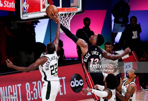 Khris Middleton of the Milwaukee Bucks blocks a shot by Bam Adebayo of the Miami Heat during overtime in Game Four of the Eastern Conference Second...