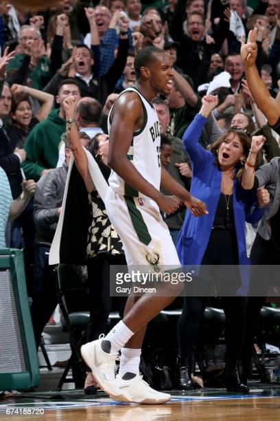 Khris Middleton of the Milwaukee Bucks celebrates after scoring against the Toronto Raptors during Game Six of the Eastern Conference Quarterfinals...