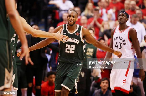 Khris Middleton of the Milwaukee Bucks celebrates with teammates after scoring a basket to tie the game during the fourth quarter against the Toronto...