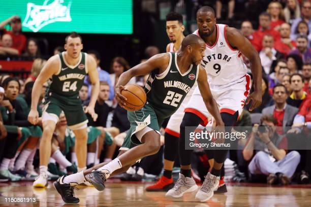 Khris Middleton of the Milwaukee Bucks dribbles during the second half against the Toronto Raptors in game four of the NBA Eastern Conference Finals...