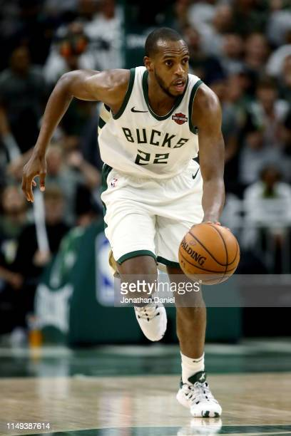 Khris Middleton of the Milwaukee Bucks dribbles the ball in the fourth quarter against the Toronto Raptors in Game One of the Eastern Conference...