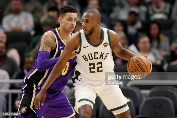 Khris Middleton of the Milwaukee Bucks dribbles the ball while being guarded by Kyle Kuzma of the Los Angeles Lakers in the third quarter at the...