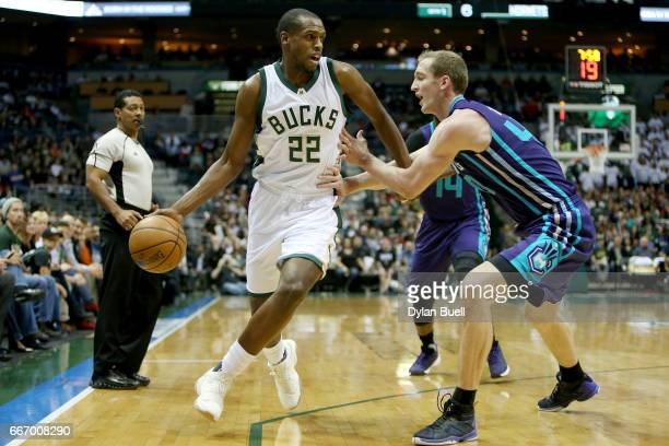 Khris Middleton of the Milwaukee Bucks dribbles the ball while being guarded by Cody Zeller of the Charlotte Hornets in the second quarter at BMO...