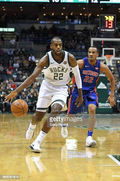 Khris Middleton of the Milwaukee Bucks drives around Avery Bradley of the Detroit Pistons during a game at the Bradley Center on December 6 2017 in...