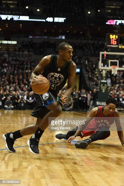 Khris Middleton of the Milwaukee Bucks drives around DeMar DeRozan of the Toronto Raptors during the first half of Game Three of the Eastern...