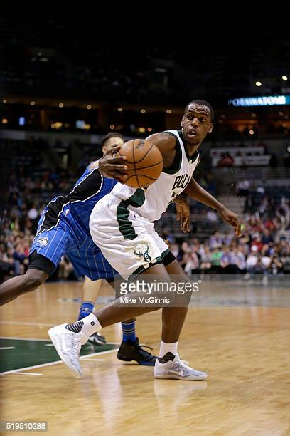 Khris Middleton of the Milwaukee Bucks drives to the hoop during the first quarter against the Orlando Magic at BMO Harris Bradley Center on April 01...