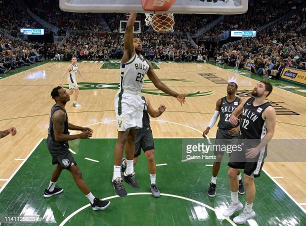 Khris Middleton of the Milwaukee Bucks dunks against the Brooklyn Nets in the second half at Fiserv Forum on April 06 2019 in Milwaukee Wisconsin...