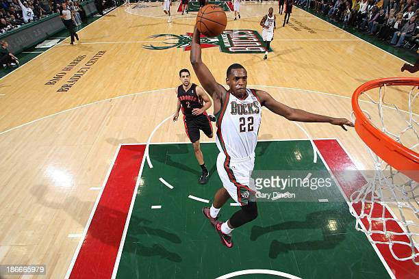 Khris Middleton of the Milwaukee Bucks dunks against the Toronto Raptors on November 2 2013 at the BMO Harris Bradley Center in Milwaukee Wisconsin...