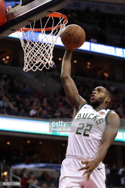 Khris Middleton of the Milwaukee Bucks dunks against the Washington Wizards during the first half at Capital One Arena on January 15 2018 in...