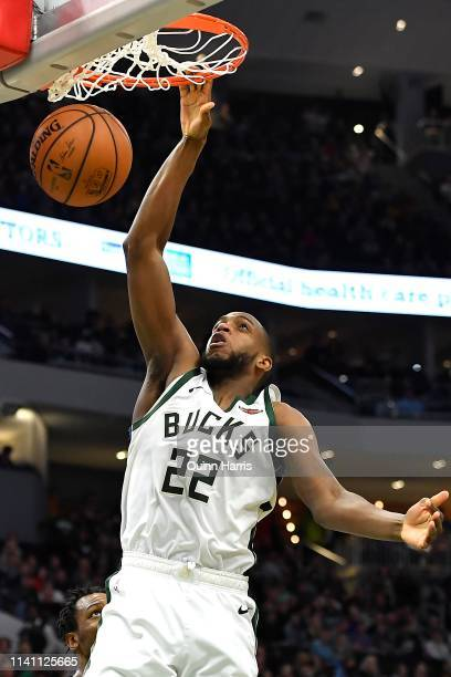 Khris Middleton of the Milwaukee Bucks dunks in the second half against the Brooklyn Nets at Fiserv Forum on April 06 2019 in Milwaukee Wisconsin...