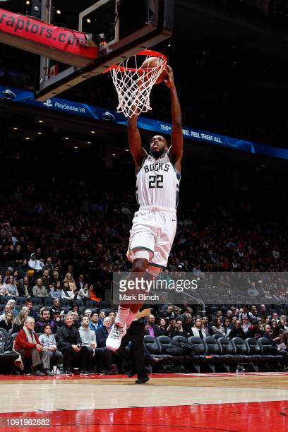 Khris Middleton of the Milwaukee Bucks dunks the ball against the Toronto Raptors on January 31 2019 at the Scotiabank Arena in Toronto Ontario...