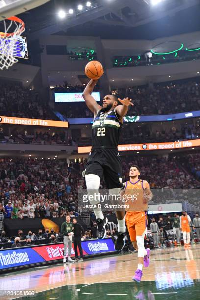 Khris Middleton of the Milwaukee Bucks dunks the ball against the Phoenix Suns during Game Six of the 2021 NBA Finals on July 20, 2021 at Fiserv...