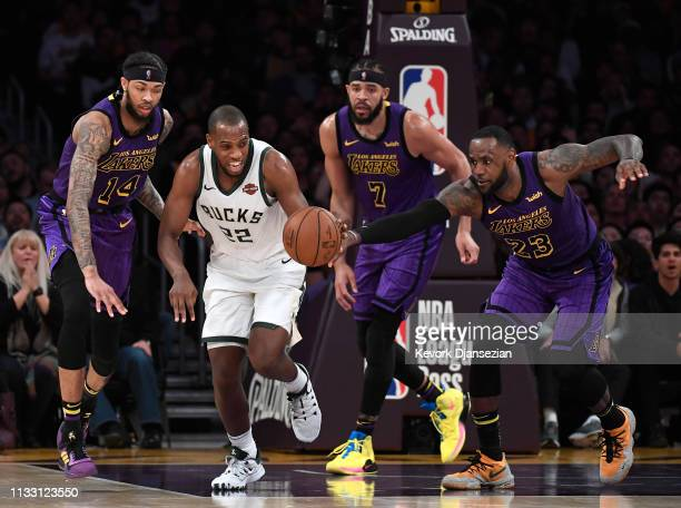 Khris Middleton of the Milwaukee Bucks goes agaisnt Brandon Ingram JaVale McGee and LeBron James of the Los Angeles Lakers during the game at Staples...