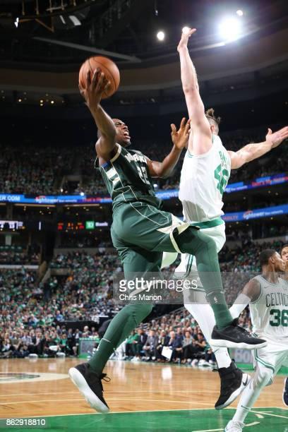 Khris Middleton of the Milwaukee Bucks goes to the basket against the Boston Celtics on October 18 2017 at the TD Garden in Boston Massachusetts NOTE...