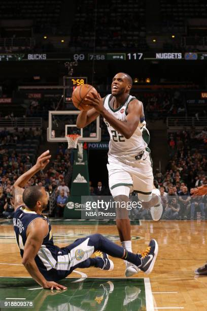 Khris Middleton of the Milwaukee Bucks goes to the basket against the Denver Nuggets on February 15 2018 at the BMO Harris Bradley Center in...