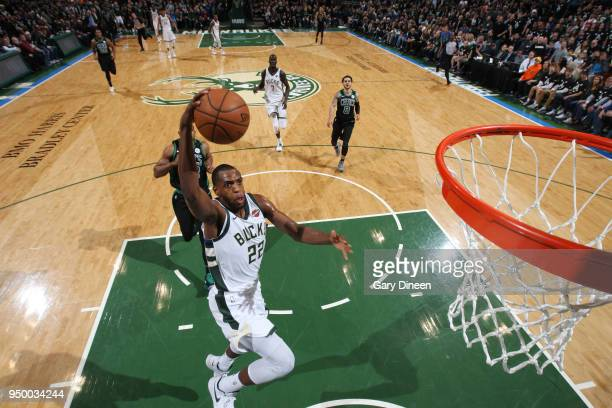 Khris Middleton of the Milwaukee Bucks goes to the basket against the Boston Celtics in Game Four of Round One of the 2018 NBA Playoffs on April 22...