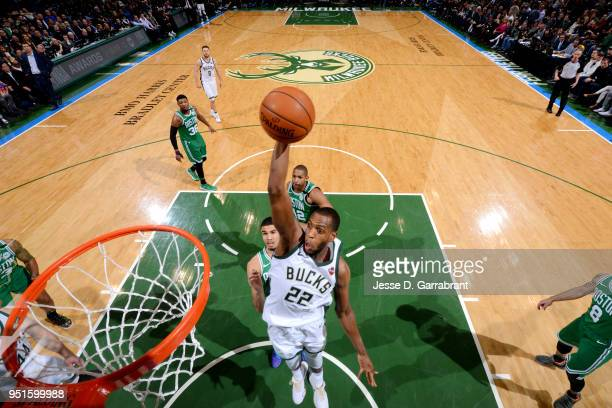 Khris Middleton of the Milwaukee Bucks goes up for a dunk against the Boston Celtics in Game Six of Round One of the 2018 NBA Playoffs on April 26...
