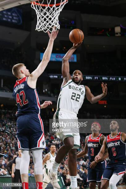 Khris Middleton of the Milwaukee Bucks goes up for a dunk during the game against the Washington Wizards on January 28 2020 at the Fiserv Forum...