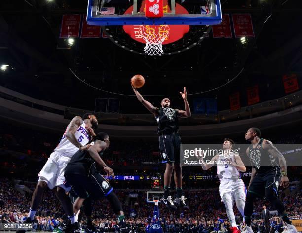 Khris Middleton of the Milwaukee Bucks grabs the rebound against the Philadelphia 76ers at Wells Fargo Center on January 20 2018 in Philadelphia...
