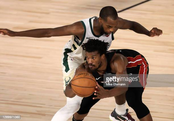 Khris Middleton of the Milwaukee Bucks guards Jimmy Butler of the Miami Heat during the fourth quarter in Game One of the Eastern Conference Second...