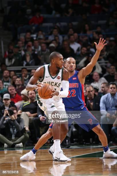 Khris Middleton of the Milwaukee Bucks handles the ball against Avery Bradley of the Detroit Pistons on December 6 2017 at the BMO Harris Bradley...