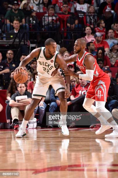 Khris Middleton of the Milwaukee Bucks handles the ball against Chris Paul of the Houston Rockets on December 16 2017 at the Toyota Center in Houston...