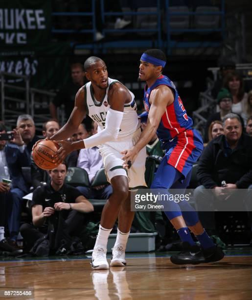 Khris Middleton of the Milwaukee Bucks handles the ball against Tobias Harris of the Detroit Pistons on December 6 2017 at the BMO Harris Bradley...